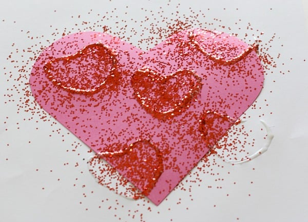 Cover glue hearts with glitter