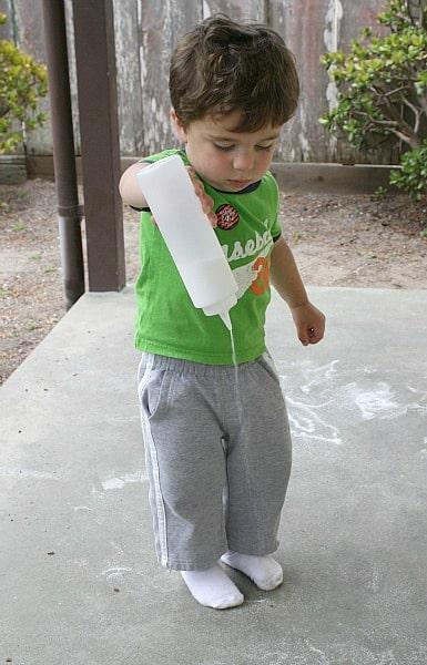 creating salt art on an outdoor surface