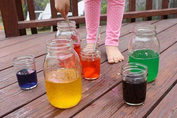 stir vinegar and food coloring