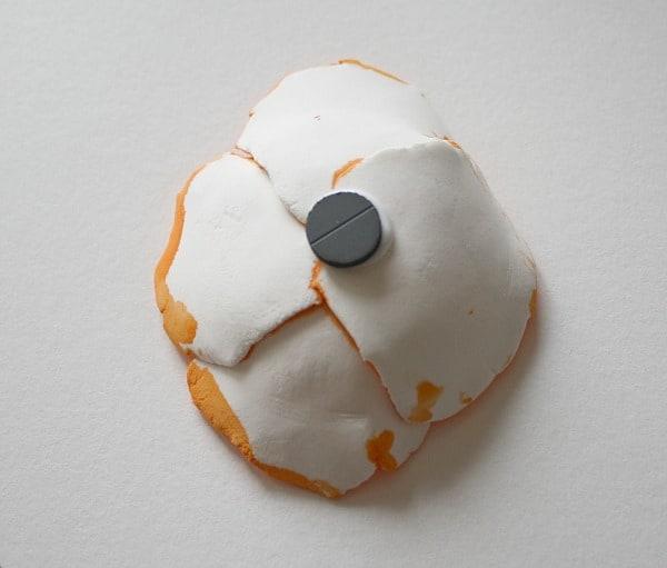 glue magnet to back of flower craft
