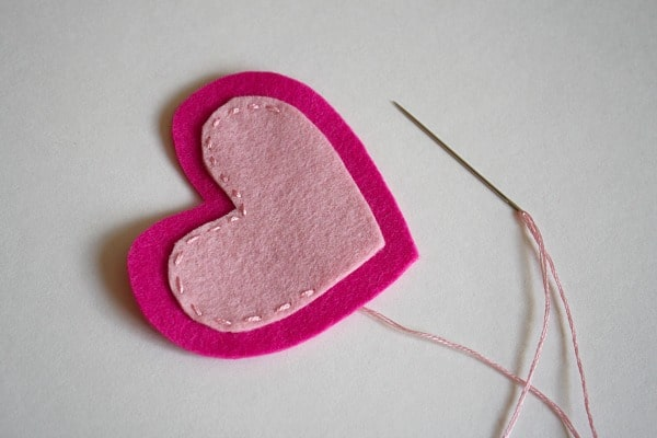 stitch two felt hearts together