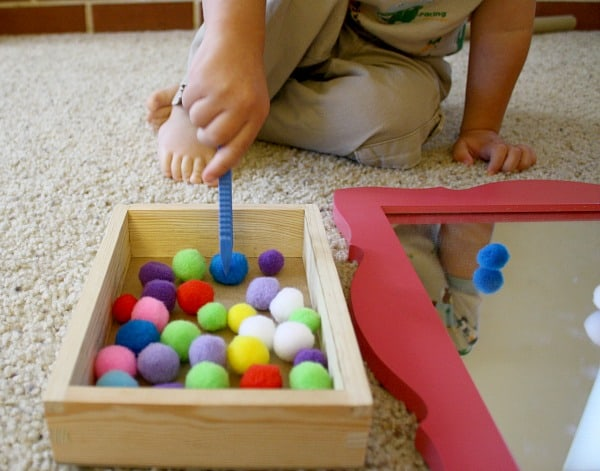 Toddler Activity: Invitation to play with pom poms and mirror