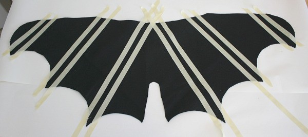 Masking tape lines on bat wings