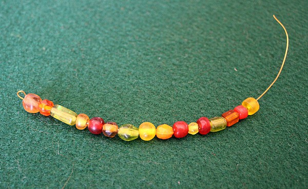 String beads onto wire