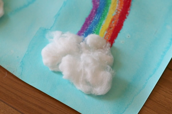cotton ball clouds on rainbow
