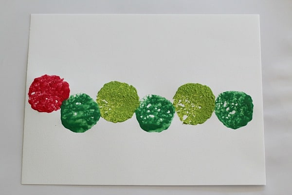 stamping a caterpillar with sponges