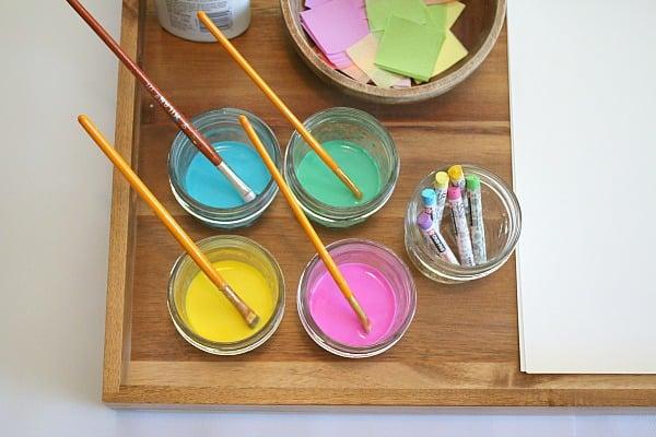 Spring colored liquid watercolors in glass jars