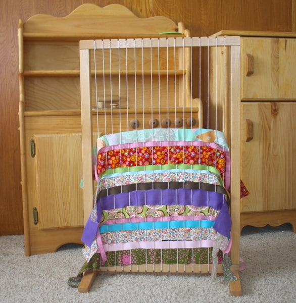 weaving on a family or classroom weaving loom with kids buggy and
