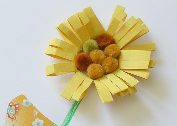put pompoms in center of flower