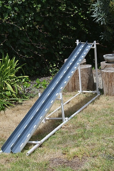 homemade car ramp using PVC pipes and rain gutters