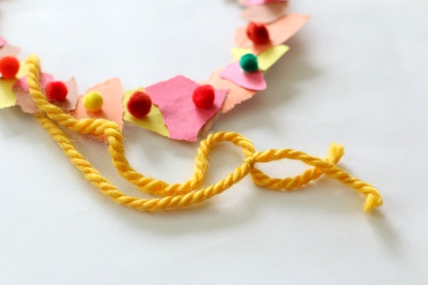 tie string onto tear art fall wreath for hanging