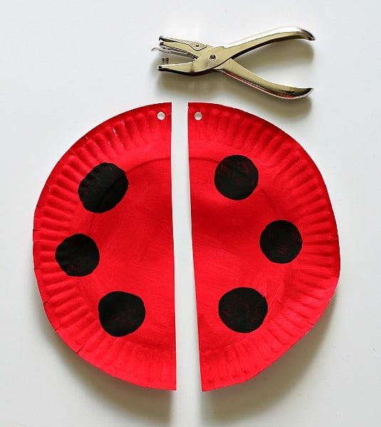 cut the red plate in half and punch two holes at the top