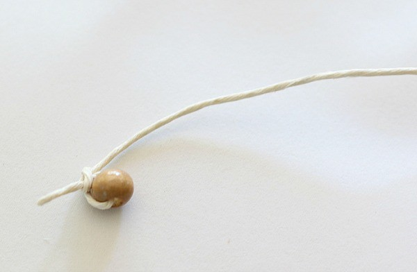 tie a bead on the end of the string