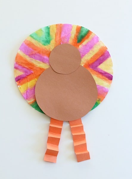 glue on the orange legs to the turkey craft for kids