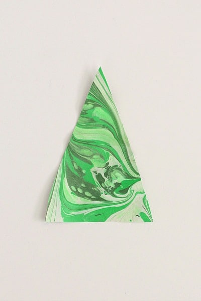 cut your paper into a triangle to make a Christmas tree shape
