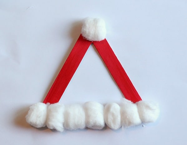 glue cotton balls on your santa hat