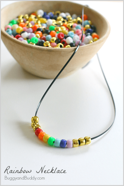 Rainbow Necklace Craft for Kids using pony beads! Learn the order of the colors in a rainbow and practice fine motor skills in this easy activity for children. (Perfect for St. Patrick's Day!) ~ BuggyandBuddy.com