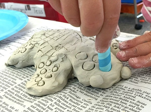 use a straw to make designs in your clay sea turtle art project for kids