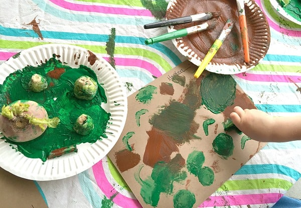 Making garden art with vegetable stamping