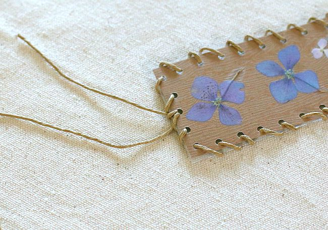tie the cord off at the top of your bookmark craft