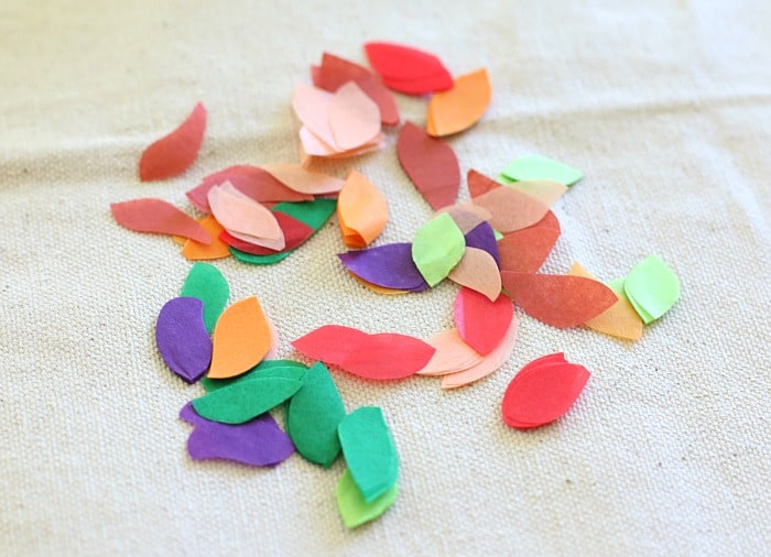 cut out little leaves from the tissue paper