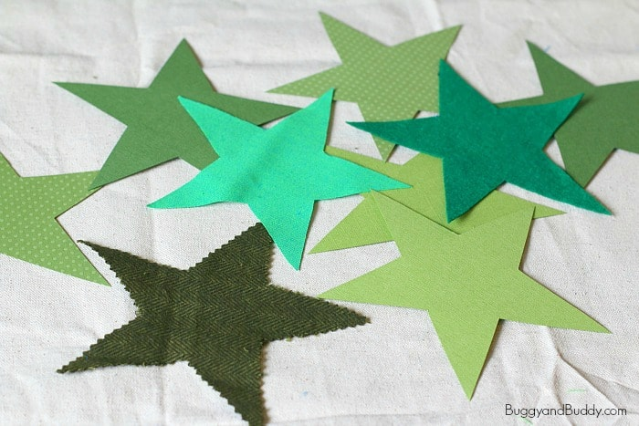 cut out the green stars for the christmas ornament craft for kids