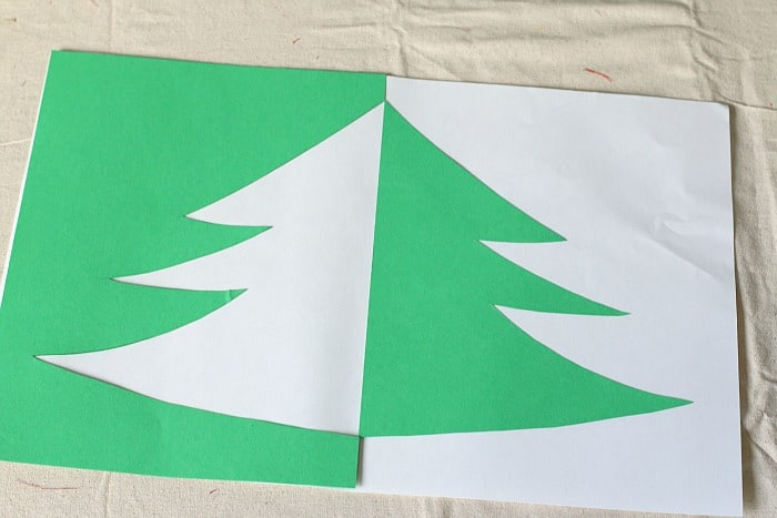 positive negative space christmas tree art project for kids