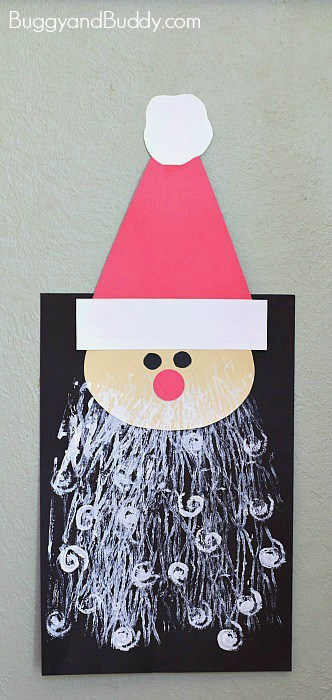 Santa Craft for Kids- Use a rolling pin and yarn to make his beard!