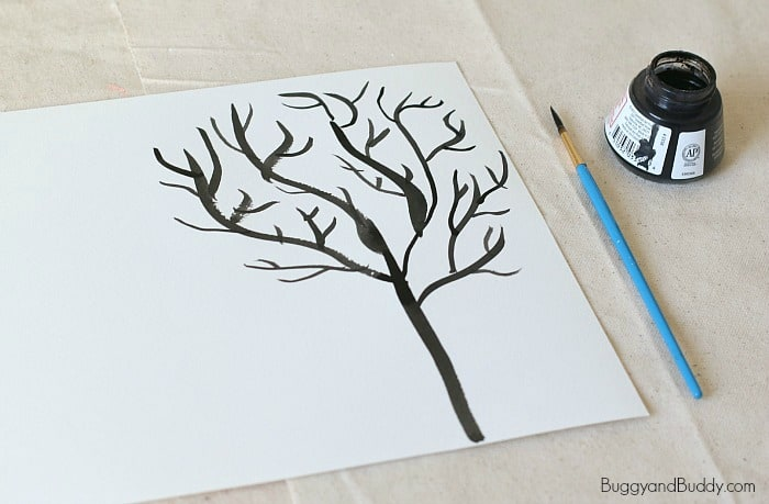 paint a winter tree using black india ink