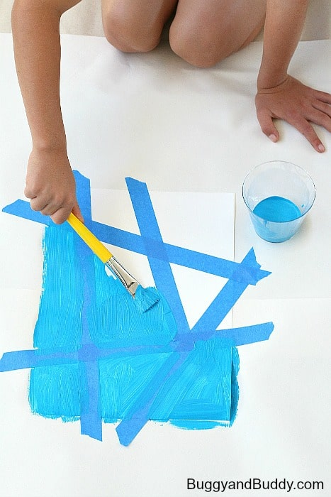 paint over your entire canvas, including over the painter's tape to create a resist effect