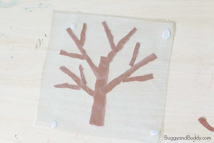winter tree suncatcher craft for kids using tear art