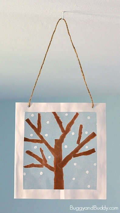 Winter Tree Suncatcher Craft for Kids using tear art and cotton swab painting- a fun winter art project for preschool, kindergarten, and elementary! ~ BuggyandBuddy.com