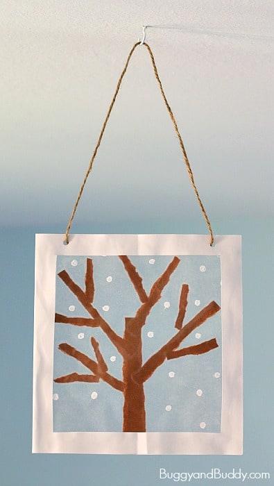 Winter Tree Suncatcher Craft for Kids using tear art and cotton swab painting- a fun winter art project for preschool, kindergarten, and elementary! ~ BuggyandBuddy.com