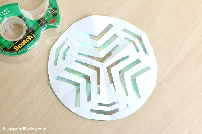 tape the paper snowflakes to the CD to compare light patterns in this science activity for kids