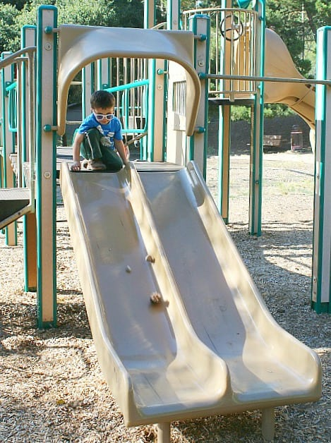 playground science for kids: exploring ramps and friction using a slide