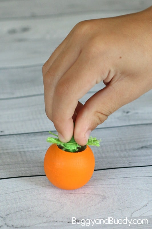 pumpkin spinning tops craft and science activity for kids for fall or Halloween