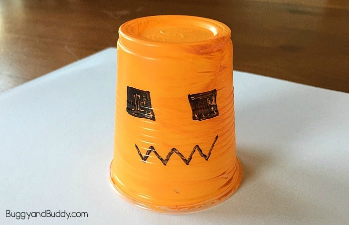 Halloween Crafts for Kids: Easy Glowing Jack-o-lantern craft using plastic cups