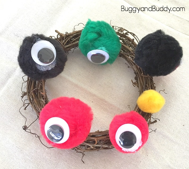 easy halloween wreath craft for kids monster eyes