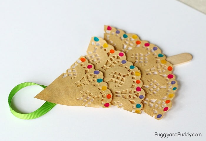 glue ribbon to the back of your doily christmas tree ornament craft for kids