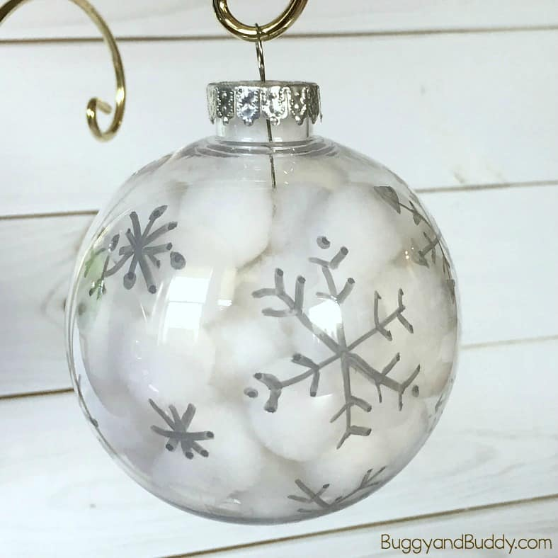 Winter Snowflake Ornament Craft for Kids: Use pom poms and clear plastic bulbs to make these easy and quick Christmas ornaments. Great fine motor practice and perfect for kids of all ages (toddler, preschool and up!)
