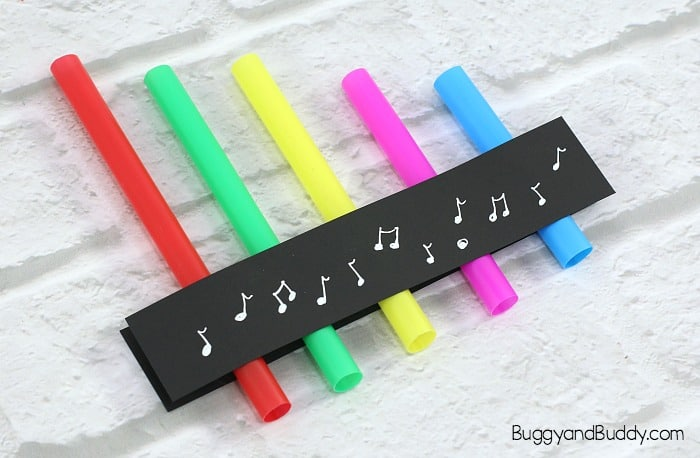 tape your straws onto the cardstock to make your pan flute science activity to explore sound