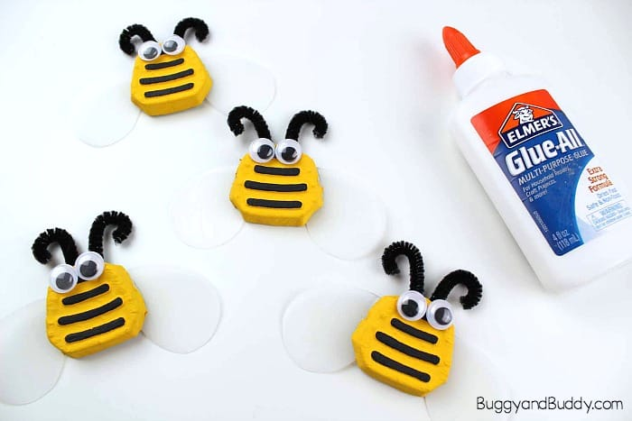 glue on your googly eyes and antennae to your bee craft for kids