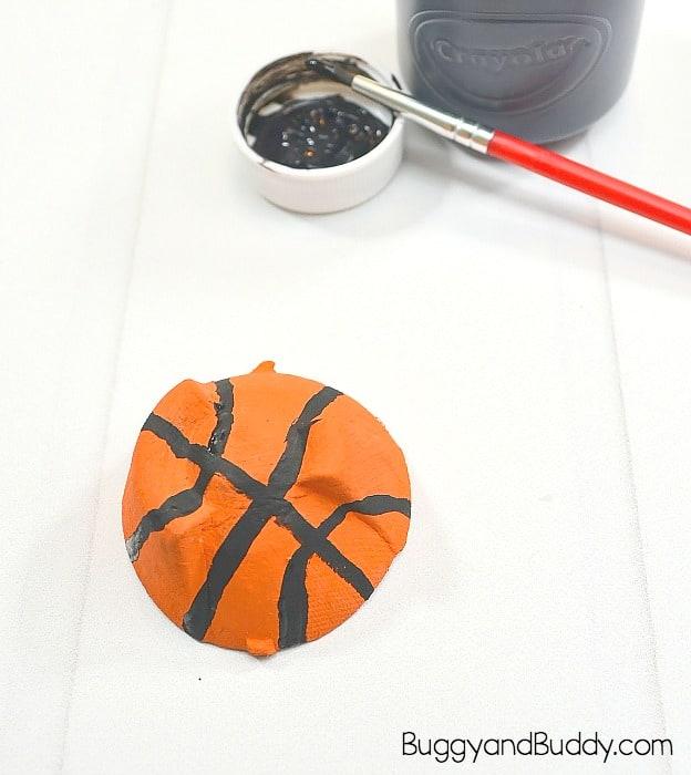 paint the egg carton to look like a basketball