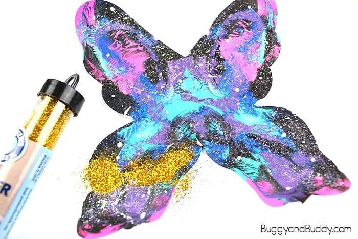add glitter to your painted butterfly craft