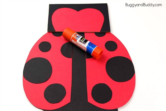 glue wings onto your paper bag ladybug
