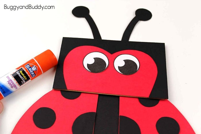 glue the eyes and antennae onto your paper bag ladybug puppet craft