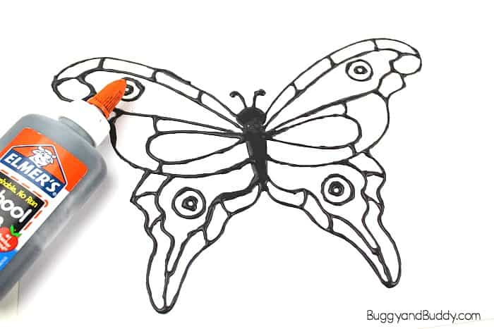 Trace over your butterfly template with the black glue.