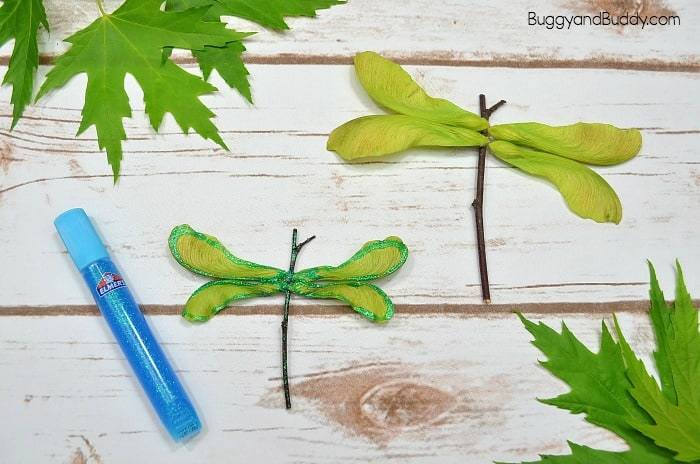 add glitter to your dragonfly craft