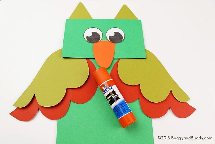 glue your owl pieces to your paper bag puppet