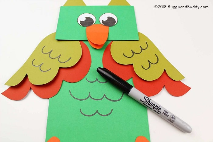 add details to your homemade puppet with a marker